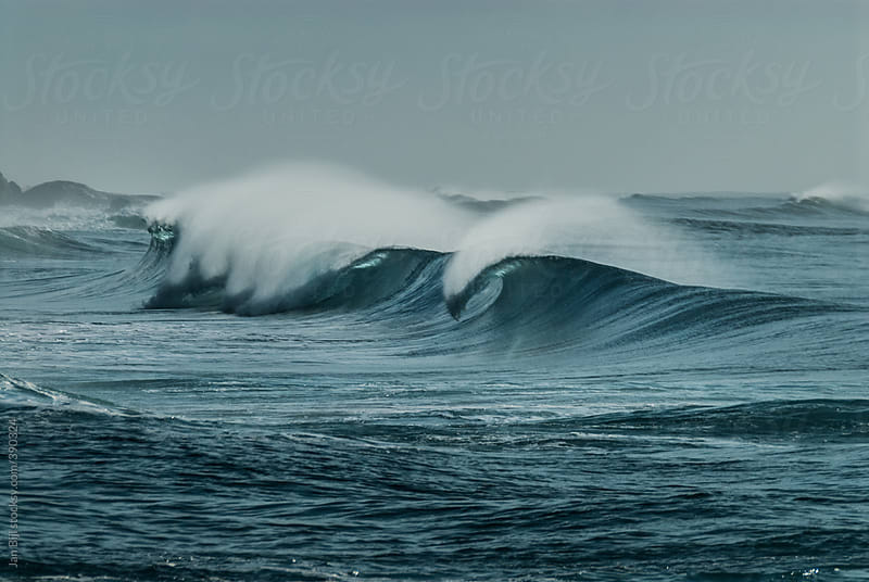 waves breaking with offshore wind  in south africa by Jan Bijl for Stocksy United