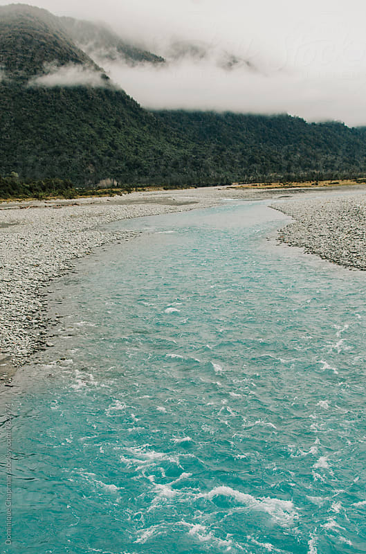 Bright blue river in New Zealand by Dominique Chapman for Stocksy United
