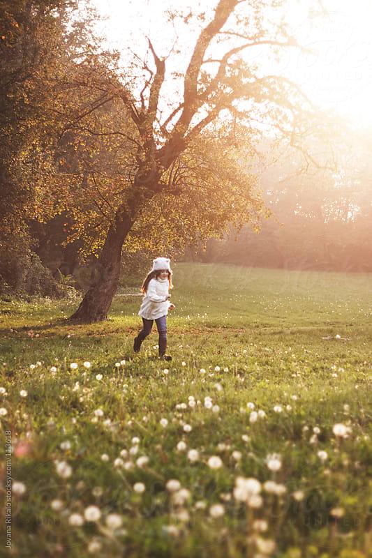 Little girl running in the park by Jovana Rikalo for Stocksy United