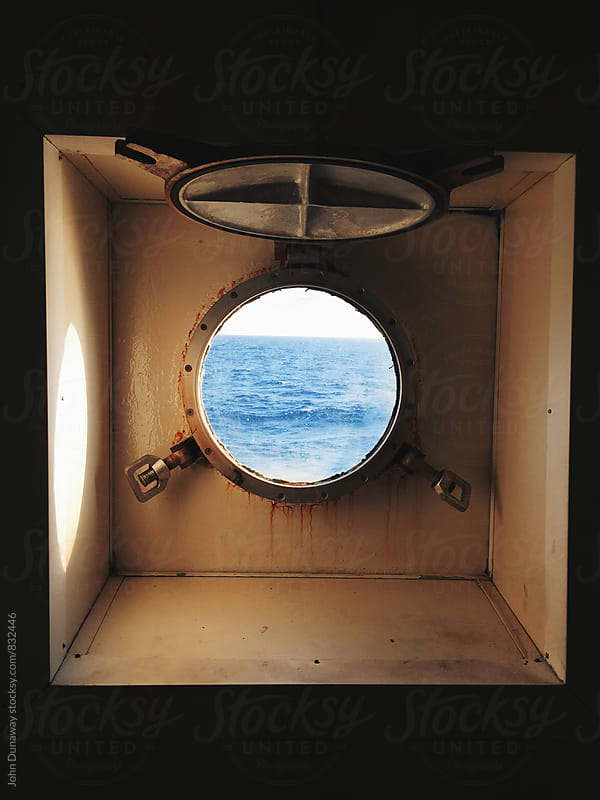 Porthole to the ocean by John Dunaway for Stocksy United