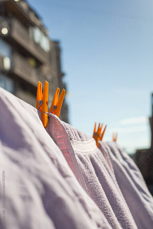 Drying laundry on the clothesline by Jelena Jojic Tomic for Stocksy United