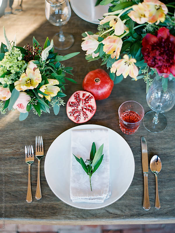 Dinner party table setting by Daniel Kim Photography for Stocksy United