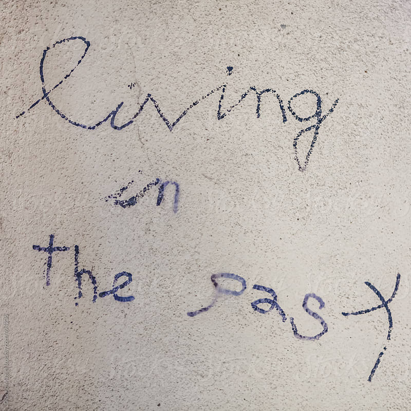 Living in the Past, Graffiti on a Plaster Wall by Giorgio Magini for Stocksy United