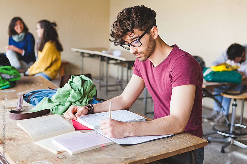 Young Man Studying for the Final Exams at College by Giorgio Magini for Stocksy United
