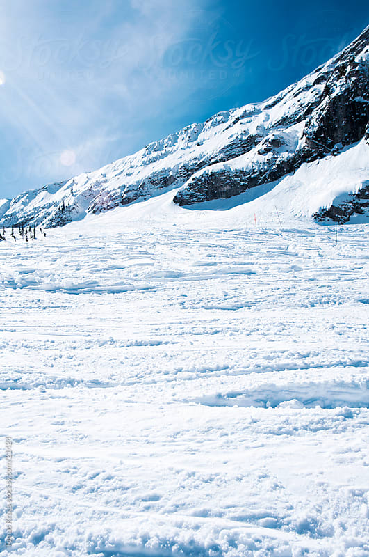 ski hill at Fernie mountain in winter by Tomas Kraus for Stocksy United