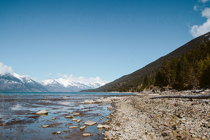 Rocky beach of beautiful Canadian lake by Justin Mullet for Stocksy United