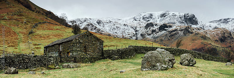 Stone barn and snow capped mountains. Hartsop, Cumbria, UK. by Liam Grant for Stocksy United