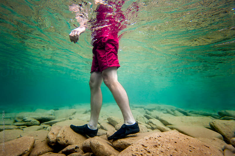 Man Wading Through Cold Clear Water by JP Danko for Stocksy United