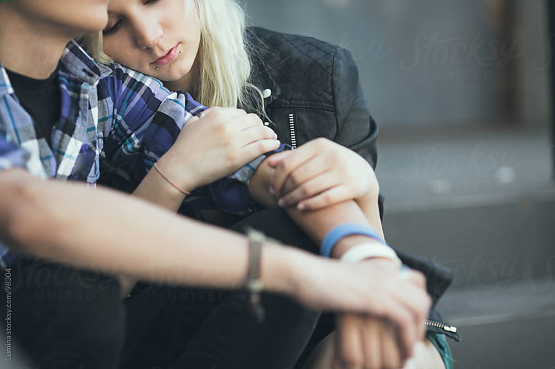 Teenage Couple Sitting on the Stairs by Lumina for Stocksy United