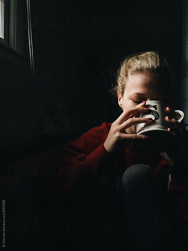 Woman Drinking Coffee in Morning Light by B. Harvey for Stocksy United