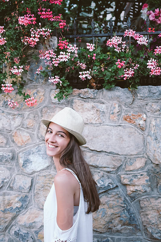 Portrait of a beautiful woman smiling  by Ani Dimi for Stocksy United