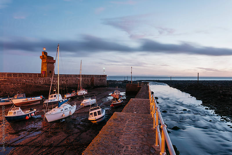 Boats in Lynmouth Harbour at dawn twilight. Devon, UK. by Liam Grant for Stocksy United