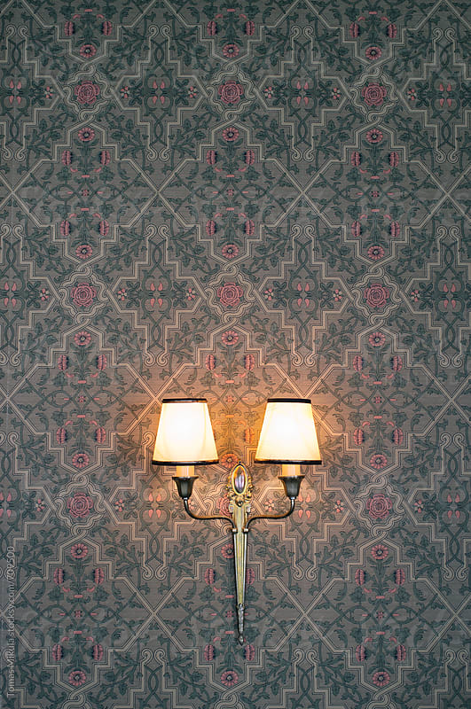 Vintage wall lamp with texture background by Tomas Mikula for Stocksy United