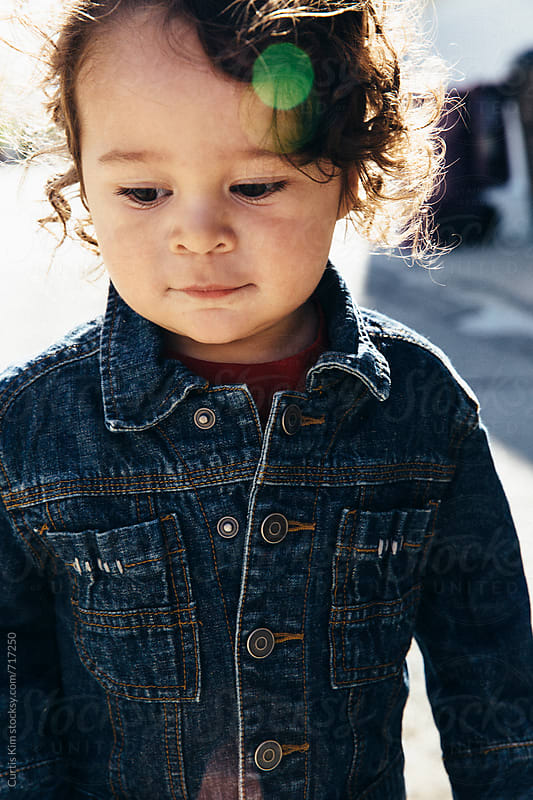 Young fashionable toddler wearing a jean jacket by Curtis Kim for Stocksy United