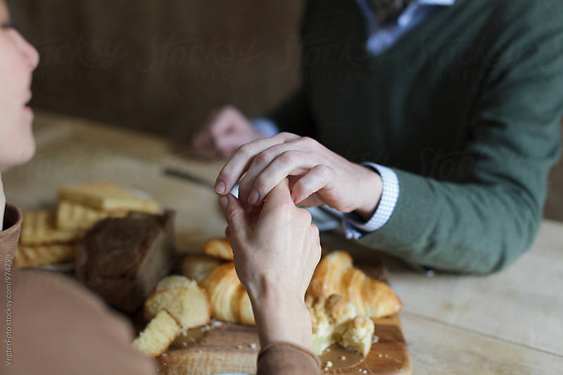 Mature Couple holding hands by VegterFoto for Stocksy United