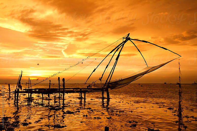 chinese fishing net at sunset by Leander Nardin for Stocksy United