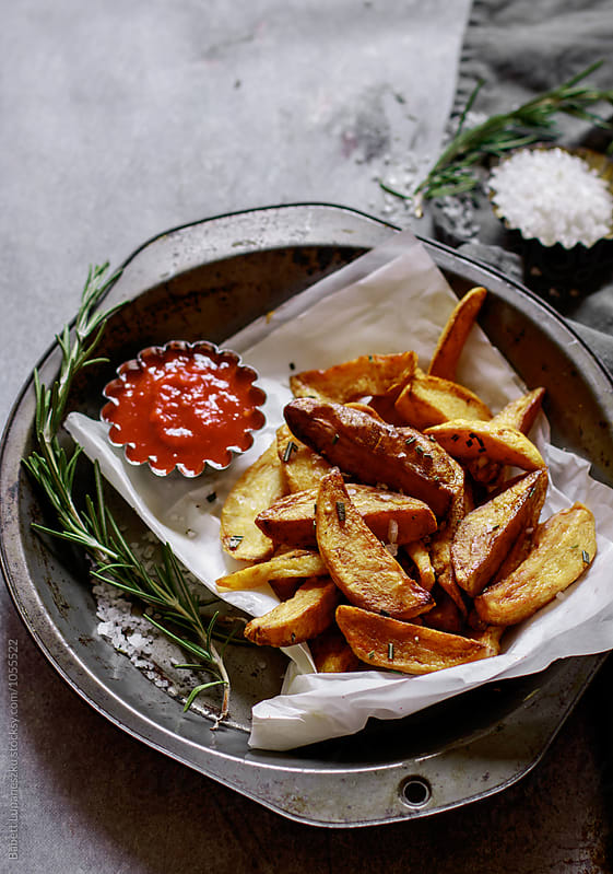 Homemade french fries with sea salt , rosemary by Viktorné Lupaneszku for Stocksy United