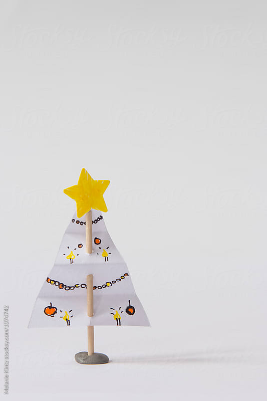 Small, handmade christmas tree on a toothpick by Melanie Kintz for Stocksy United