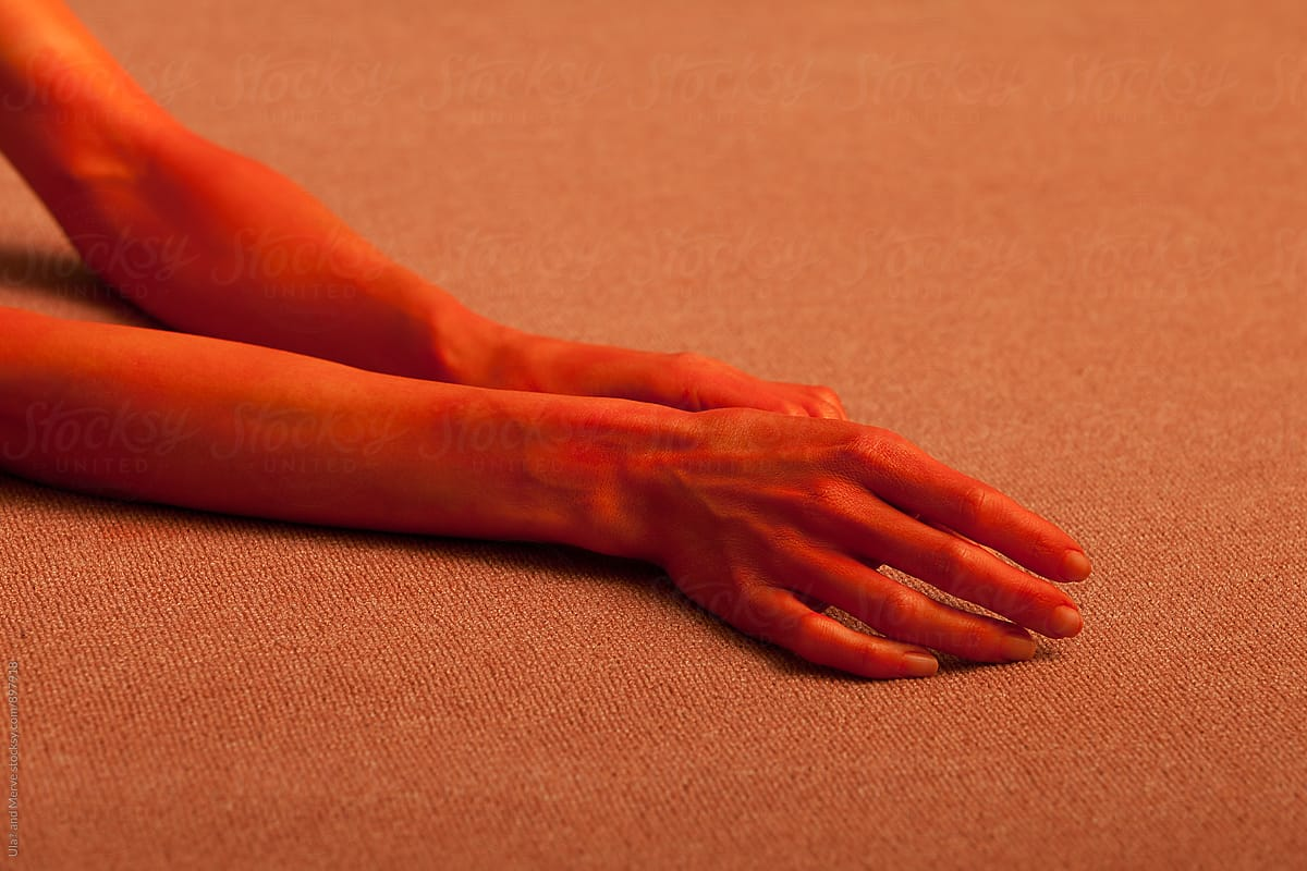 75b0b1815b871 Stock Photo - Red Painted Hand Of A Young Lady On Floor
