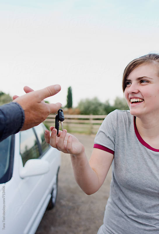 Teenager gets keys to her first car by Tana Teel for Stocksy United