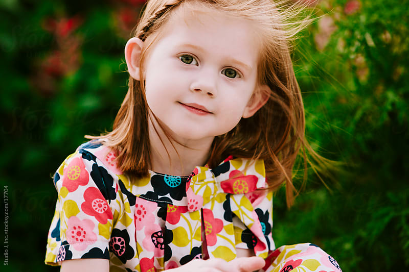 Outdoor Portrait of a Little Girl with Red Hair by Jani Bryson for Stocksy United