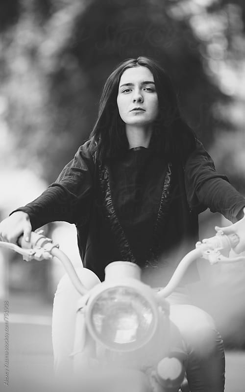 young woman with  bike by Alexey Kuzma for Stocksy United