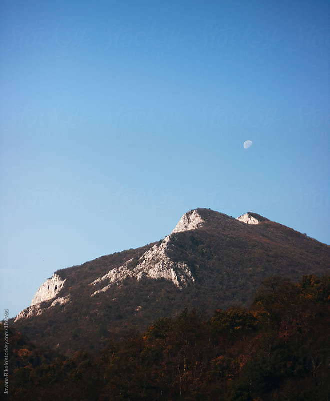 Moon above the mountain by Jovana Rikalo for Stocksy United