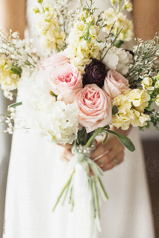 Bride holding a bouquet  by Ellie Baygulov for Stocksy United