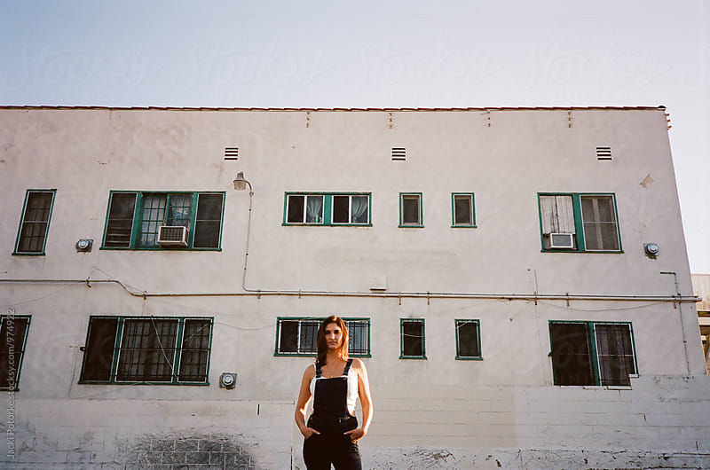 Woman in front of city building by Jacki Potorke for Stocksy United