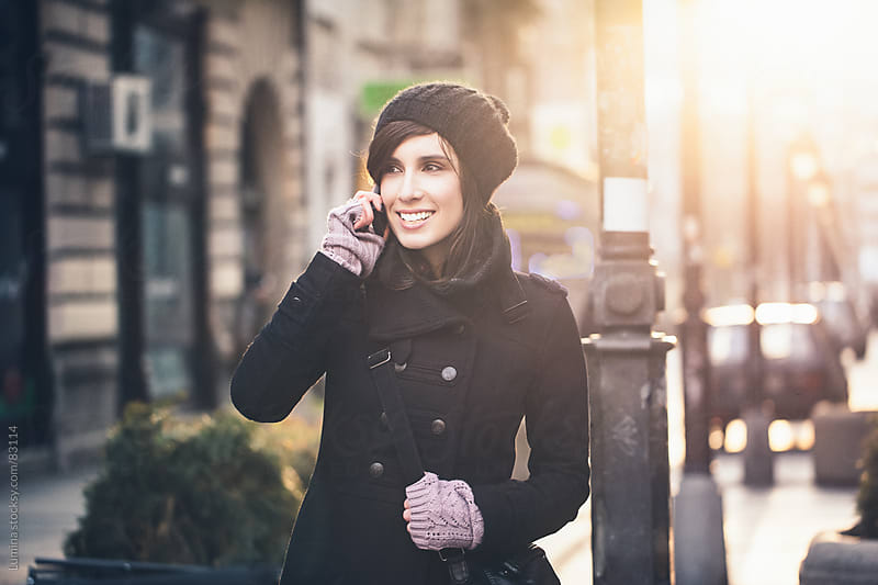 Smiling Woman Telephoning Outdoors by Lumina for Stocksy United