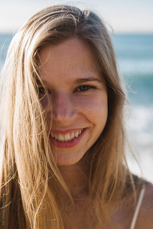 Happy and smiling young woman portrait by GIC for Stocksy United