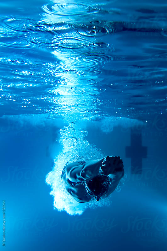 Underwater Swimmer Diving Into Pool by JP Danko for Stocksy United