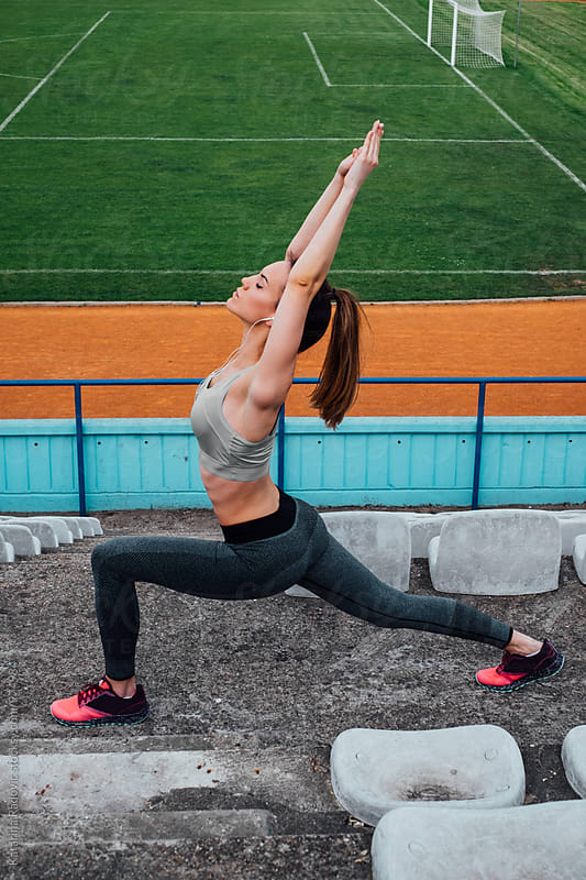 Beautiful Fit Woman Stretching Before Workout by Katarina Radovic for Stocksy United