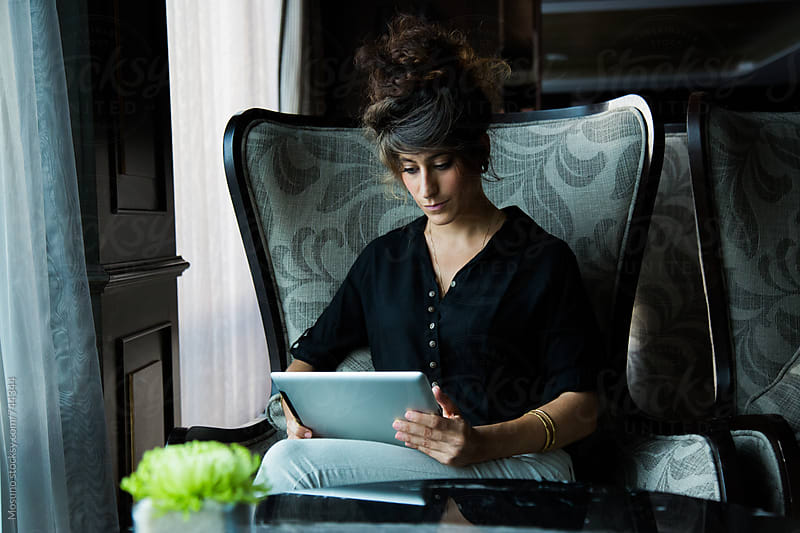 Woman Using Technology by Mosuno for Stocksy United