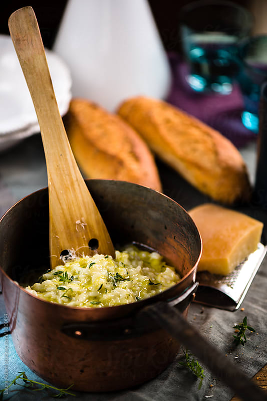 a risotto with leeks, pecorino and thyme by Laura Adani for Stocksy United