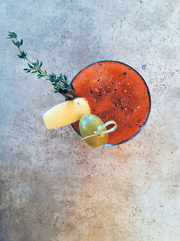Overhead Shot of a Bloody Mary Cocktail on a Bar by Jared Harrell for Stocksy United
