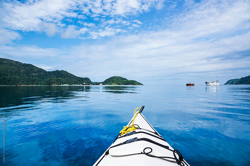 Kayaking in blue ocean in Okinawa by yuko hirao for Stocksy United