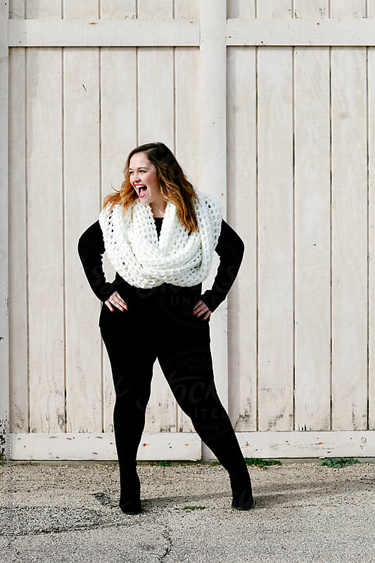 Beautiful woman wearing oversized scarf by Jennifer Brister for Stocksy United