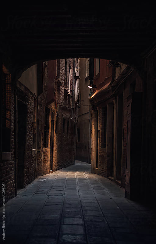 Narrow back alley in Venice during evening.Italy by Marko Milanovic for Stocksy United