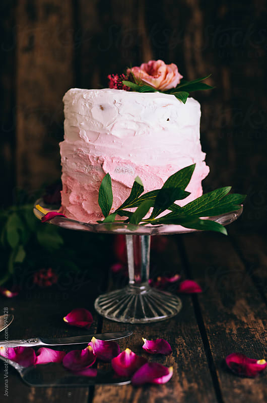 cake decorated with flowers by Jovana Vukotic for Stocksy United
