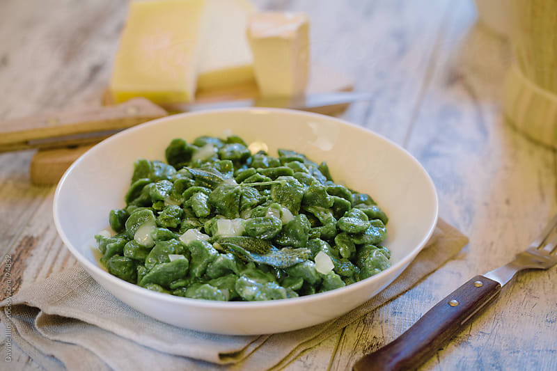 Green gnocchi with cheese by Davide Illini for Stocksy United