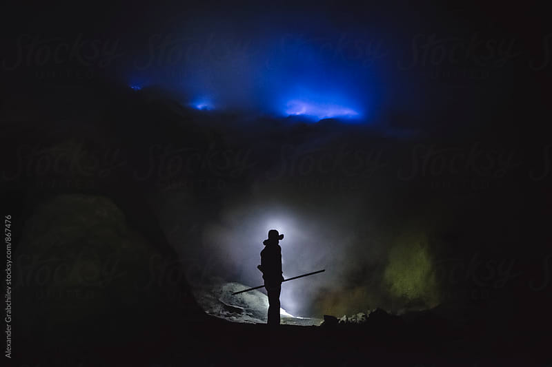 Sulfur Miner. Kawah Ijen Volcano by Alexander Grabchilev for Stocksy United