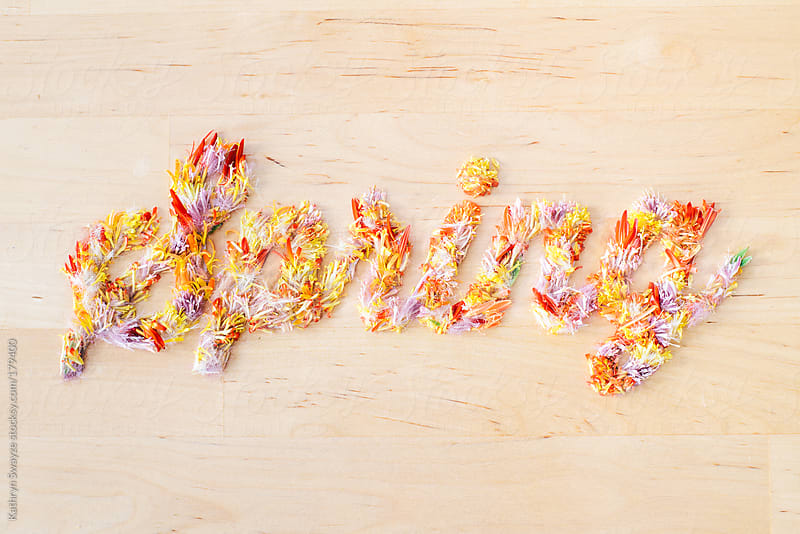 Flower petals spelling out the word Spring by Kathryn Swayze for Stocksy United