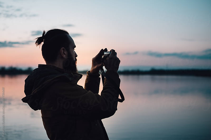 Man Taking Photos of the Beautiful Lake by Katarina Radovic for Stocksy United
