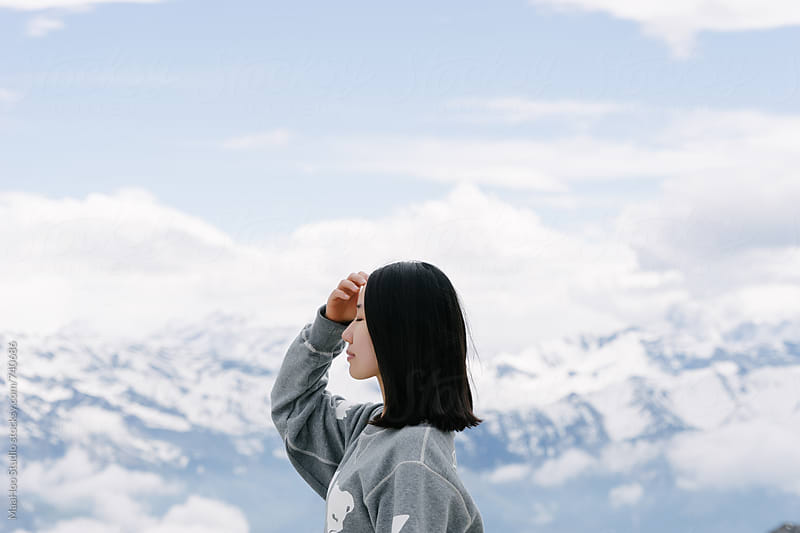 Side profile of a woman looking away, Swiss Alps, Switzerland by Maa Hoo for Stocksy United