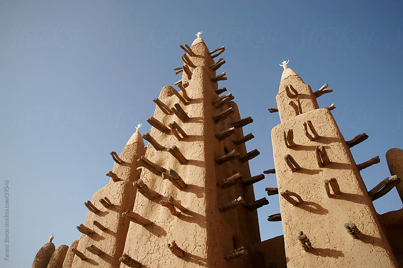 Facade with three minarets of adobe mosque in Teli, Dogon countr by Ferenc Boros for Stocksy United
