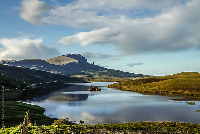 Small Loch with the old man of Storr in the back, Isle of Skye,  by Leander Nardin for Stocksy United