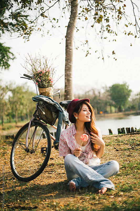 Woman Relaxing next to her Bike  by Marija Savic for Stocksy United