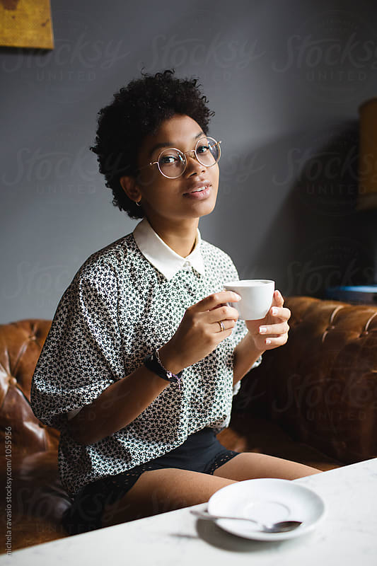 Portrait of beautiful girl drinking a coffee by michela ravasio for Stocksy United