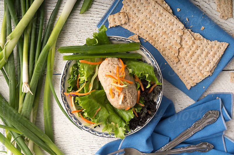 Tradition Jewish Passover dish Gefilte Fish by Jeff Wasserman for Stocksy United